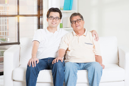 dads: Asian senior father and adult son at home. Family living lifestyle. Stock Photo