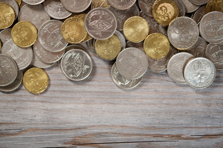 gold and silver coins: Top view coins on old wooden desk with copy space on bottom. Stock Photo