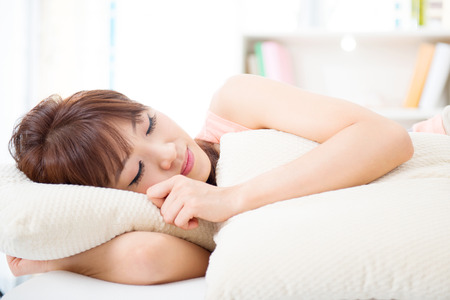 Portrait of attractive Asian girl sleeping on bed. Young woman indoors living lifestyle at home. Reklamní fotografie