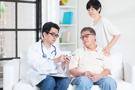 asian hospital: Doctor and patient healthcare concept.