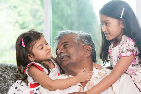 indian people:  Asian grandfather and granddaughters having sweet conversation.