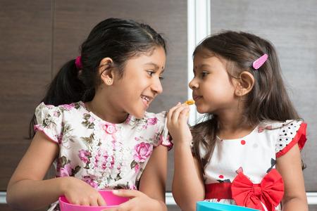 malaysian food:   Cute Indian Asian girls enjoying food.