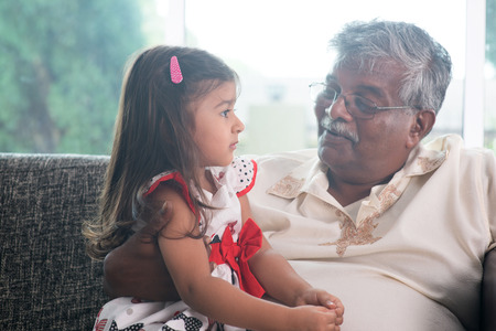 Portrait Indian family at home. Grandparent and grandchild talking together. Asian people living lifestyle. Grandfather and granddaughter. Banco de Imagens