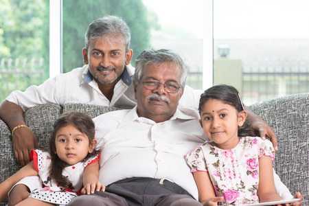 healthy kid: Portrait of multi generations Indian family at home  Stock Photo
