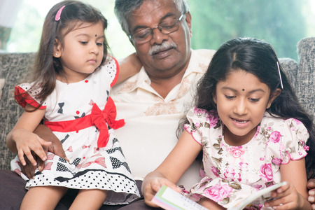 three story:   Asian grandfather and granddaughters reading story book