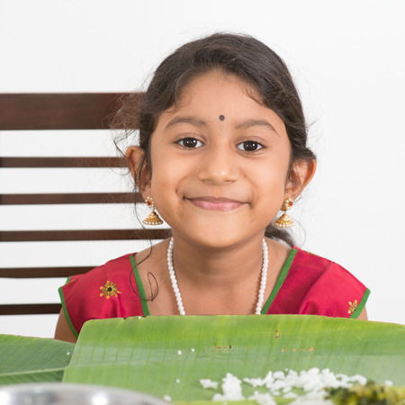 eating banana: Indian family dining at home. Photo of Asian child eating rice. India culture. Stock Photo