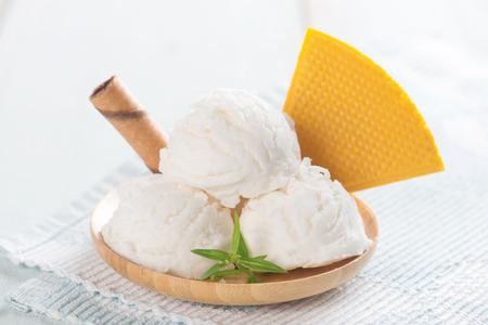 Close up vanilla ice cream with waffle.