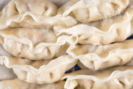 dumpling: Top view close up fresh dumpling on plate with hot steams. Stock Photo