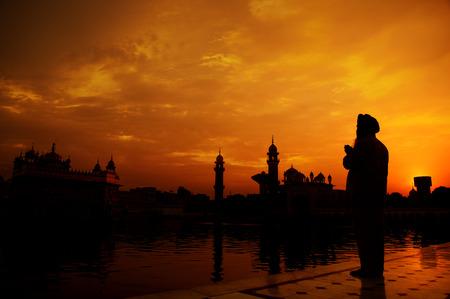 sikh: Silhouette of Sikh prayer at golden temple, Amritsar, India