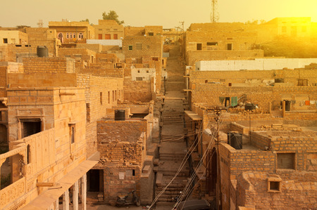 jaisalmer: Jaisalmer city view, ancient brick houses in the sunset.
