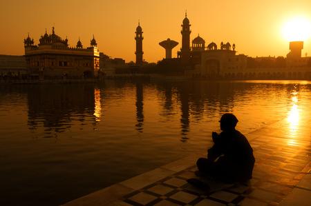 sunset lake: Sikh pilgrims sitting beside the holy pool,Golden Temple,Amritsar,Punjab state,India,Asia