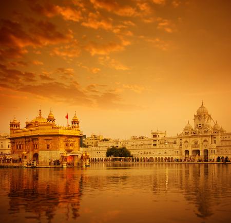 temple tank: Golden sunlight at Golden Temple in Amritsar, Punjab, India. Stock Photo
