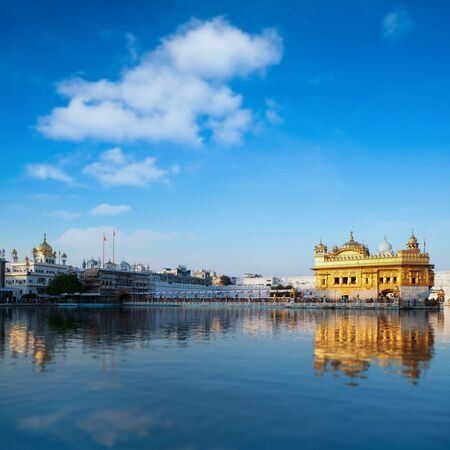 temple tank: Golden Temple in Amritsar with blue sky in daytime, Punjab, India. Stock Photo