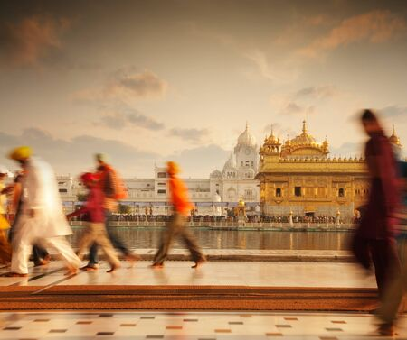 sikh: Group of Sikh pilgrims walking by the holy pool, Golden Temple, Amritsar, Pun jab state, India, Asia