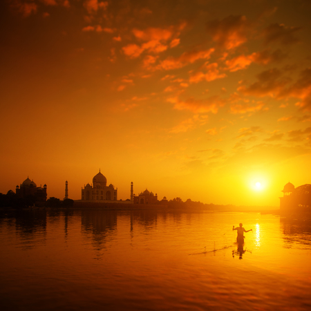 india fisherman: Taj Mahal in Agra, India in golden sunset with silhouette of fisherman.
