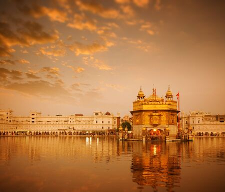 temple tank: Sunrise at Golden Temple in Amritsar, Punjab, India.