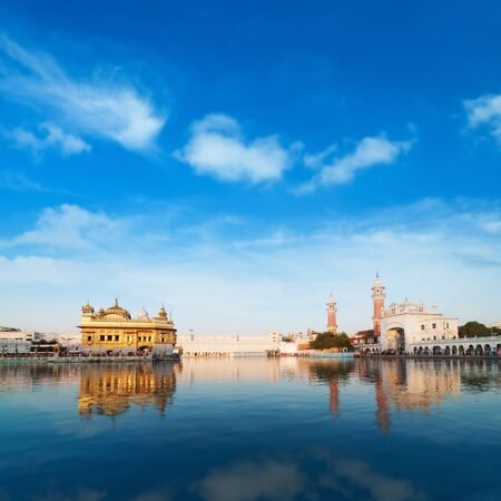 temple tank: Golden Temple in Amritsar with blue sky, Punjab, India. Stock Photo
