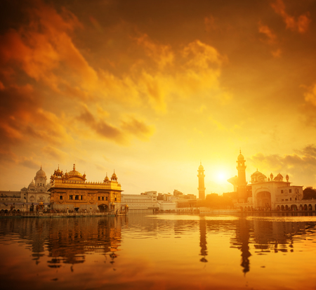 temple tank: Golden sunset at Golden Temple in Amritsar, Punjab, India. Stock Photo
