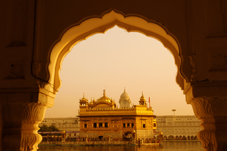 amritsar: Amritsar Golden Temple - India. Framed with windows from west side. focus on temple