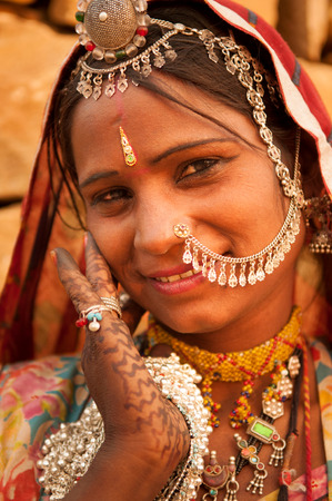 sari: Beautiful Traditional Indian woman in sari dress smiling, India people. Stock Photo