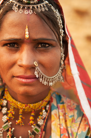 beautiful black woman: Traditional Indian woman in sari costume covered her head with veil, India people. Stock Photo