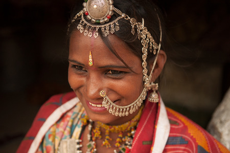sari: Close up portrait of smiling traditional Indian woman in sari dress, India people.