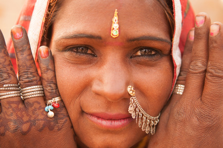 Portrait of Traditional Indian woman in sari costume covered her head with veil, India people photo