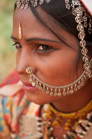 indian culture: Close up portrait of traditional Indian woman in sari dress, with sad emotion, India people. Stock Photo