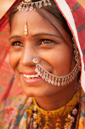 Portrait of Traditional Indian woman in sari costume covered her head with veil, India photo