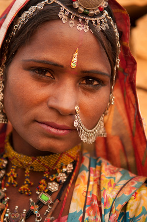 Close up portrait of traditional Indian woman in sari dress, India people. photo