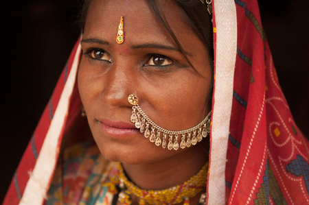 Close up portrait of thoughtful traditional Indian woman in sari dress, India people. photo