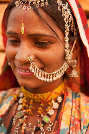 Portrait of beautiful traditional Indian woman in sari costume covered her head with veil, India people photo