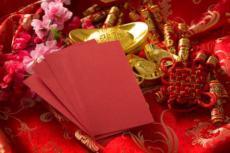 Chinese new year festival decorations, blank ang pow or red packet with copy space ready for text. Stock Photo