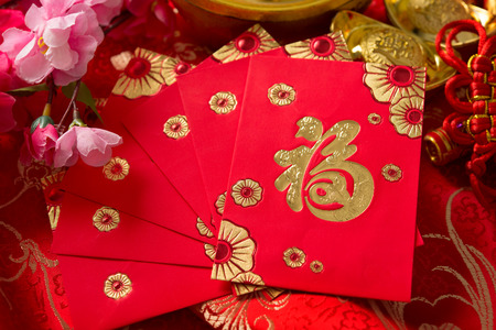 red packet: Chinese new year festival decorations, ang pow or red packet. Chinese character means good fortune, not logo and copyright. Stock Photo