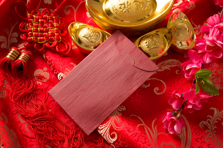 envelope decoration: Chinese new year festival decorations, blank ang pow with copy space ready for text.