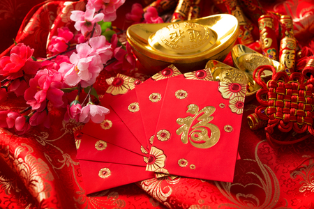 ang: Chinese new year festival decorations, ang pow or red packet and gold ingots. Chinese character means good fortune, not logo and copyright.