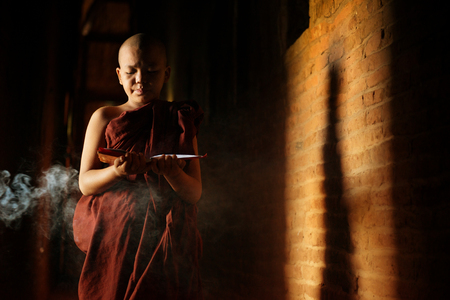 novice: Young novice monk learning inside monastery. Stock Photo