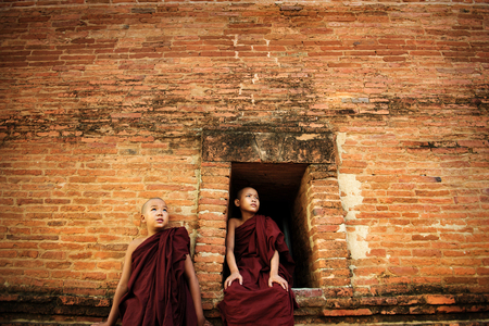 novice: Young Buddhist novice monks at outside monastery, pagan, Myanmar. Stock Photo