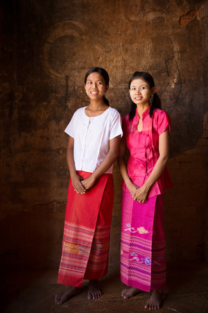 young friends: Full length portrait of beautiful young traditional Myanmar girls smiling.