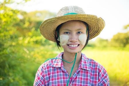 thanaka: Portrait of a young Burmese female farmer with thanaka powdered face. Stock Photo