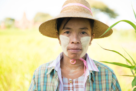thanaka: Portrait of a mature Burmese female farmer with thanaka powdered face who works in the field.