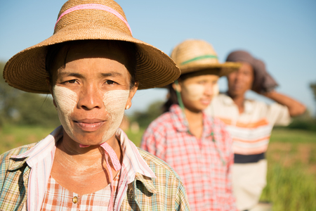 Portrait of a Asian Burmese farmers standing at paddy field.