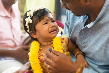 traditional events: Baby girl prepared for the karnvedh events. Traditional Indian Hindus ear piercing ceremony. India special rituals.