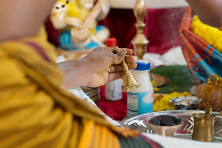 hindus: Traditional Indian Hindus ear piercing ceremony. Focus on the hand. India special rituals.
