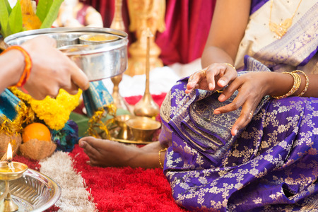 traditional events: Woman received prayers from priest. Traditional Indian Hindus ear piercing ceremony. India special rituals events. Stock Photo