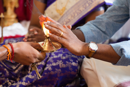 traditional events: People received prayers from priest. Traditional Indian Hindus praying ceremony. Focus on the oil lamp. India special rituals events.