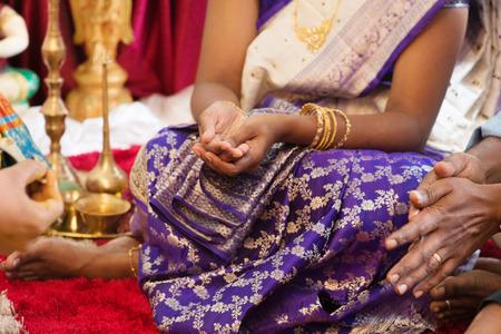 traditional events: Woman received prayers from priest. Traditional Indian Hindus religious ceremony. India special rituals events.