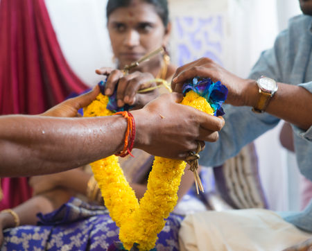 hindus: People received flower garland from priest. Traditional Indian Hindus ear piercing ceremony. India special rituals.
