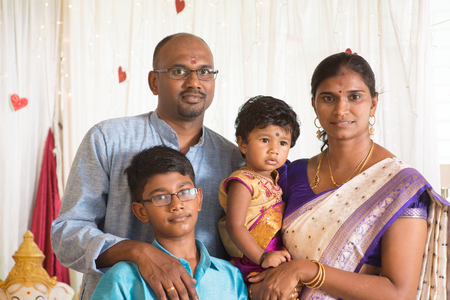 Indian parents and children in a blessing ceremony. Traditional India family portrait.