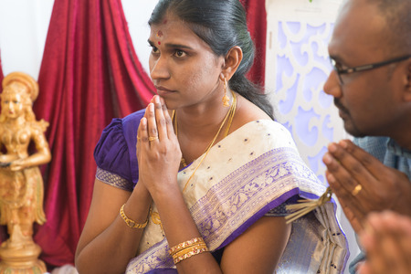 south asian ethnicity: People pray during praying events. Traditional Indian Hindus ear piercing ceremony. India special rituals.
